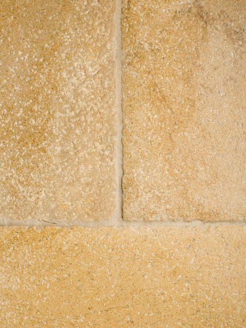 Aged limestone floor tiles