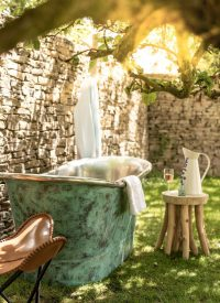 oxidised copper bath outdoors